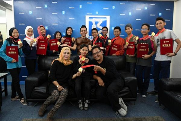 Gong daripada tong dram iringi kejayaan emas Sekolah Seni Perak di Beijing